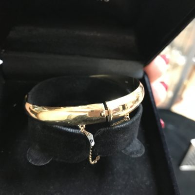 9 Carat Yellow Gold Bangle with Safety Chain