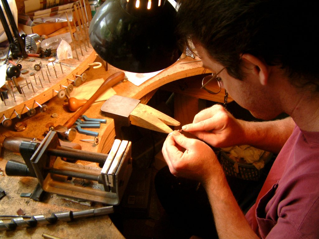 Jeweller repairing antique jewellery at Cherubs in the Clouds